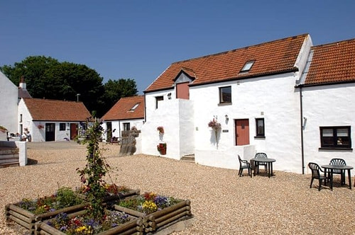 Pretty Pembrokeshire cottages with 12th Century courtyard charm...
